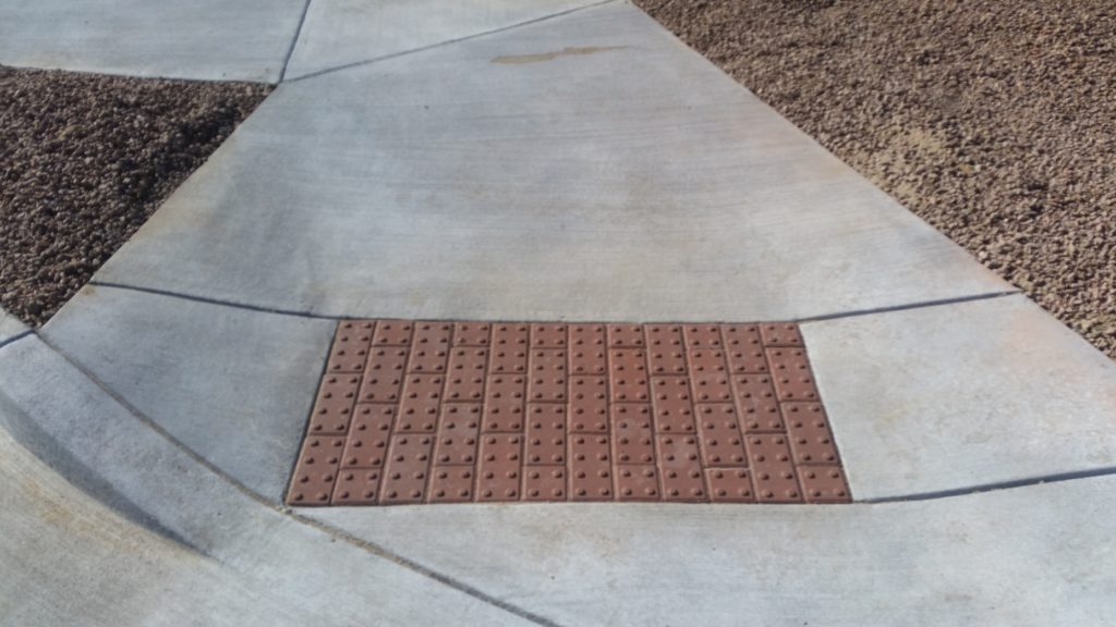 Handicap Ramp Broom Finish with Bricks